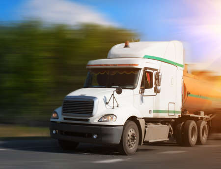 fuel truck: fuel truck goes on highway to sunny day