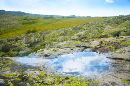 deepening: landscape with pool in stone deepening after rain Stock Photo