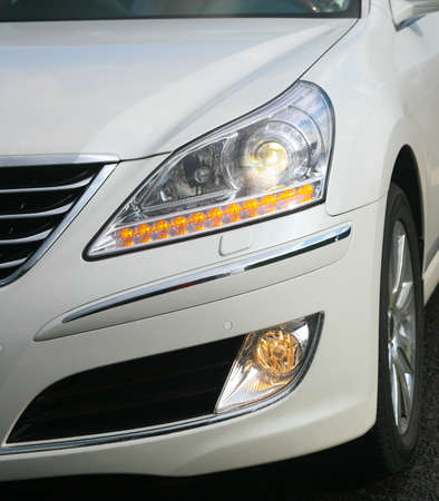 headlights: headlight of modern white car close up