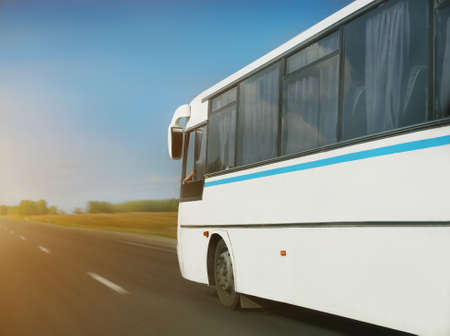 country highway: white bus goes on  country highway