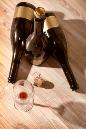 corked: bottles with red wine stopper and an empty wine glass Stock Photo