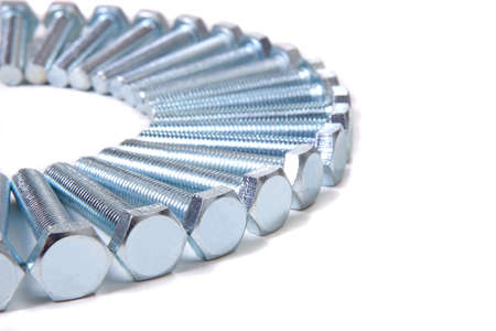 fasteners: shiny chromeplated bolts by semicircle isolated Stock Photo