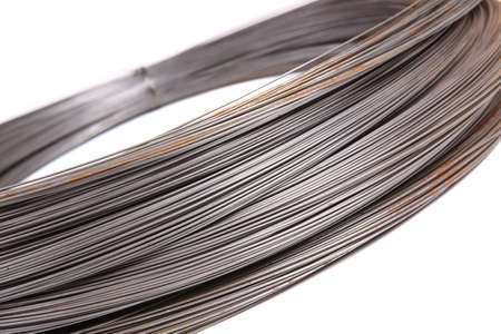 steel wire: roll of metal wire on white background Stock Photo