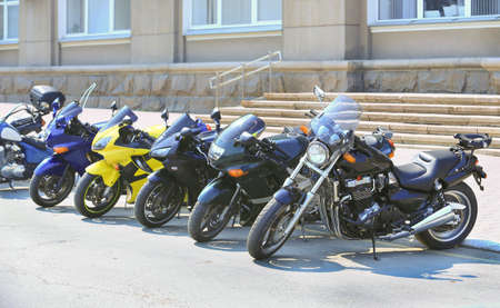 different motorcycles on parking on asphalt  close up 스톡 콘텐츠