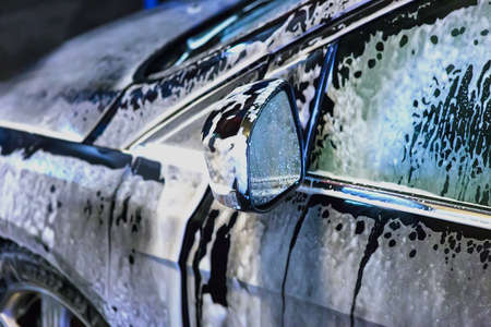 presure: car covered with foam on car wash Stock Photo