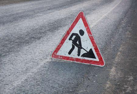 roadwork: triangular road sign roadwork on asphalt Stock Photo