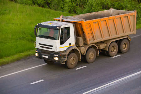 mining ships: big dump truck goes on country highway