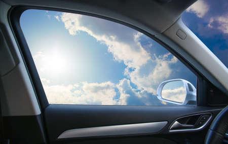Heavenly landscape behind  car window Banque d'images