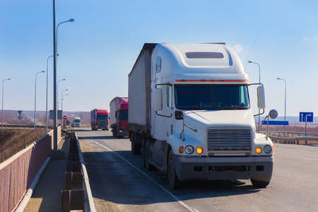 convoy: convoy trucks move on the country highway Stock Photo