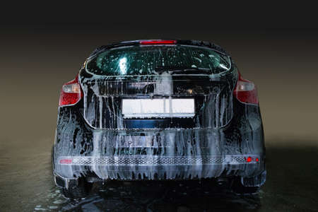 cleaning car: car covered with foam on car wash Stock Photo