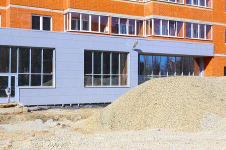 urban decline: facade of the new building under construction Stock Photo
