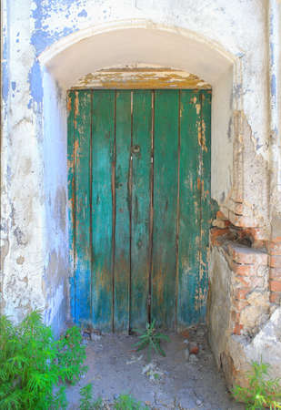 arches: old wooden arch door in an old brick wall