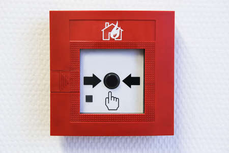 alarm button: button of the fire alarm system on wall inside