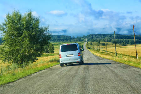 minibus: minibus on the country highway against landscape