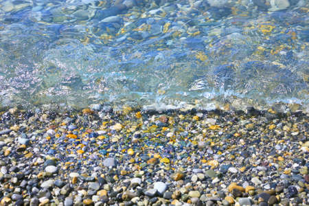 pebbles: smooth pebble under water on the river bank