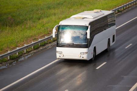 tourist bus goes on asphalted country  highway Stok Fotoğraf