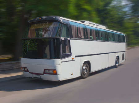 tourist feature: tourist bus goes on the highway in the summer