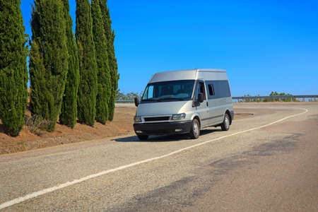 minibus: minibus goes on mountain road in summer Stock Photo