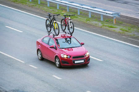 car carrier: car with two bicycles on the top luggage carrier