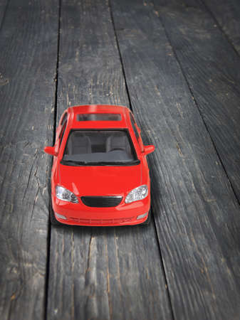 timber floor: red toy car on timber floor