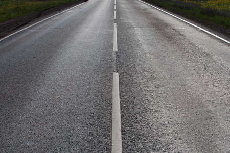 asphalt paving: asphalt paving on highway turn close up Stock Photo