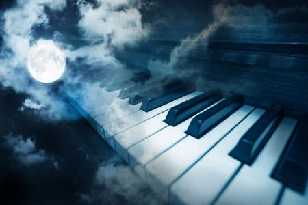 surreal: piano keys in moonlight cloudy night