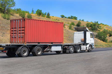 car carrier: trailer transports container on highway in country