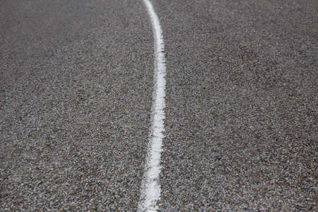 dividing: asphalt paving on highway turn close up Stock Photo