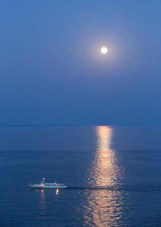 full frames: ship in Black Sea at moonlight summer night