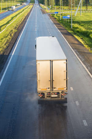 transport truck: truck transports freight on  country highway