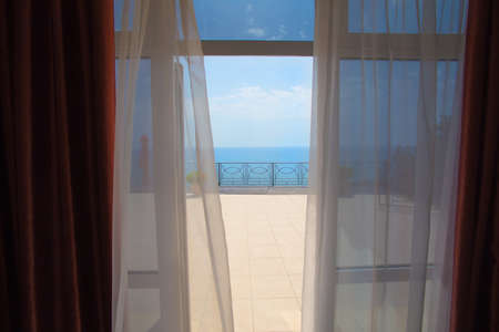 seaside resort: view of the sea from a hotel room in the summer