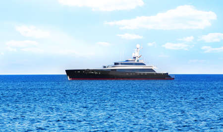 cruise travel: beautiful yacht at the sea in the summer