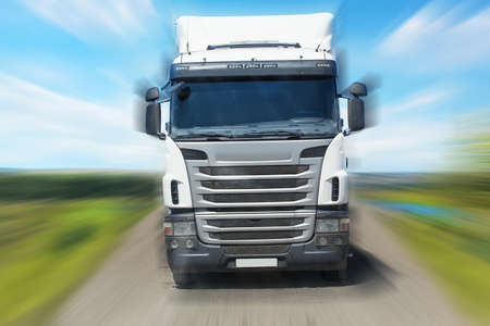 truck moves frontally on the highway in the country 写真素材