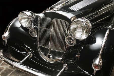 black car: ancient luxury black car against dark background