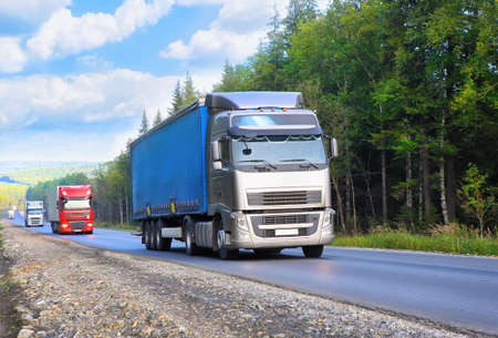 country highway: escort of trucks moves on the country highway