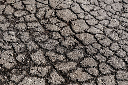 crazed: lot of cracks on the old asphalted road