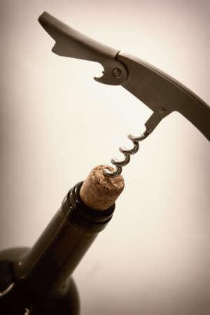 stopper: corkscrew in stopper from bottle of red wine