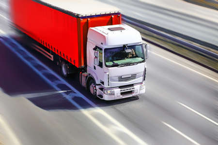 lorry: big powerful truck moves on highway Stock Photo
