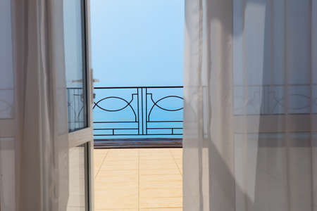 view on sea: view of the sea from a hotel room in the summer
