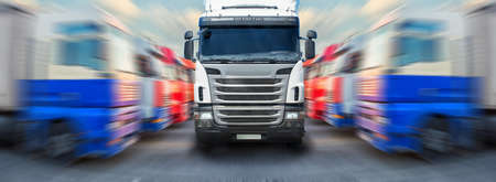 in the ranks: truck goes frontally along ranks of trucks