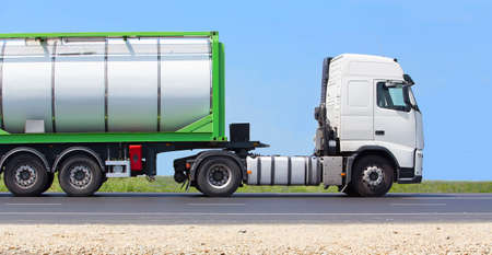 country highway: white truck transports freight on the country highway Stock Photo