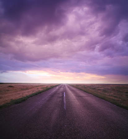 beautiful sunset in cloudy sky over road