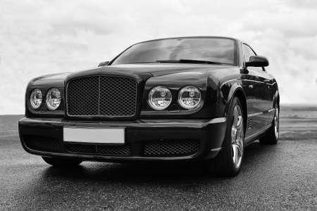 the case before: prestigious car on road against sky monochrome
