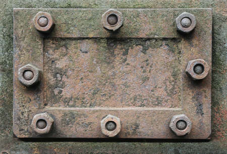 rusty metal hatch with nuts