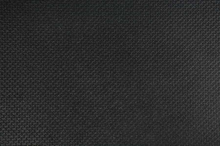 features: background black rough textural fabric