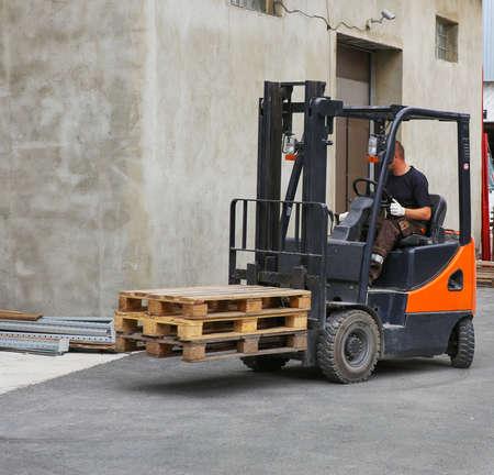 loader: worker on loader transports pallets