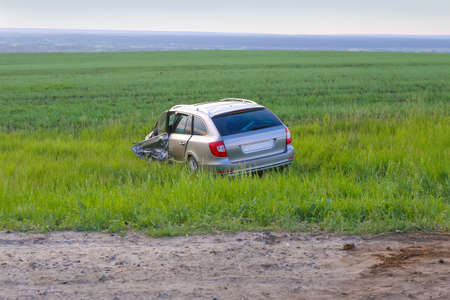 wrack: broken by car after accident in field at road