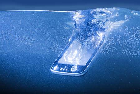 water fall: modern smartphone closeup thrown into water