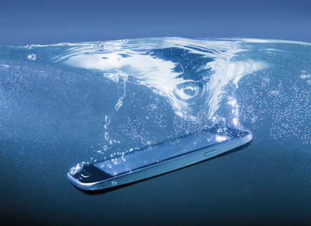cellular: modern smartphone closeup thrown into water