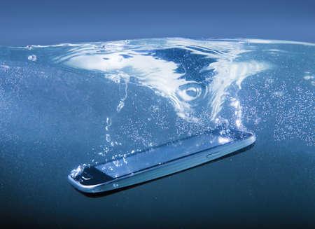 modern smartphone closeup thrown into water